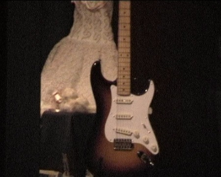 Buddy's_guitar_and_Maria_Elena's_Wedding_Dress.jpg